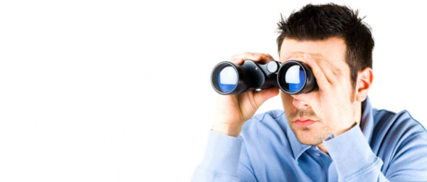 Man-looking-through-binoculars-600x256