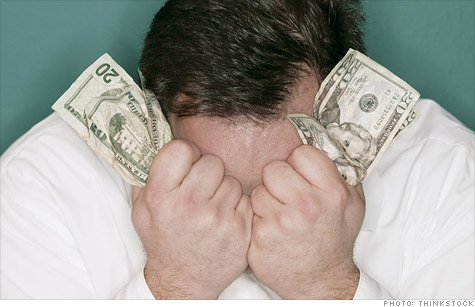 man-clutching-money.ju_.top_